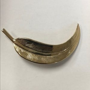 Eucalyptus or feather shaped pin